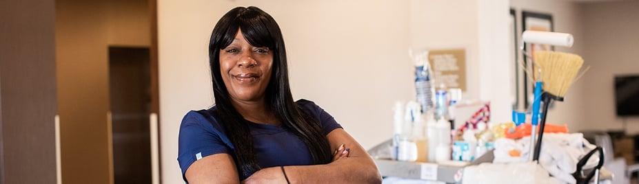 Rashawn Berry smiling by housekeeping cart