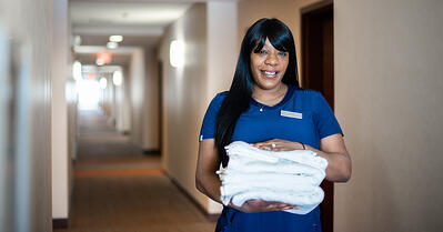 hotel housekeeper with towels