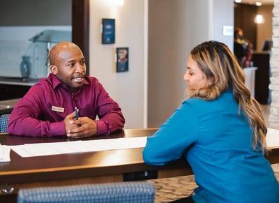hotel staff members talking